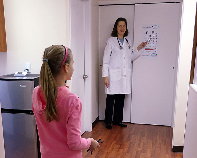 Holmdel, NJ pediatric office - Dr. Yelena Potylitsina conducting an eye screening exam