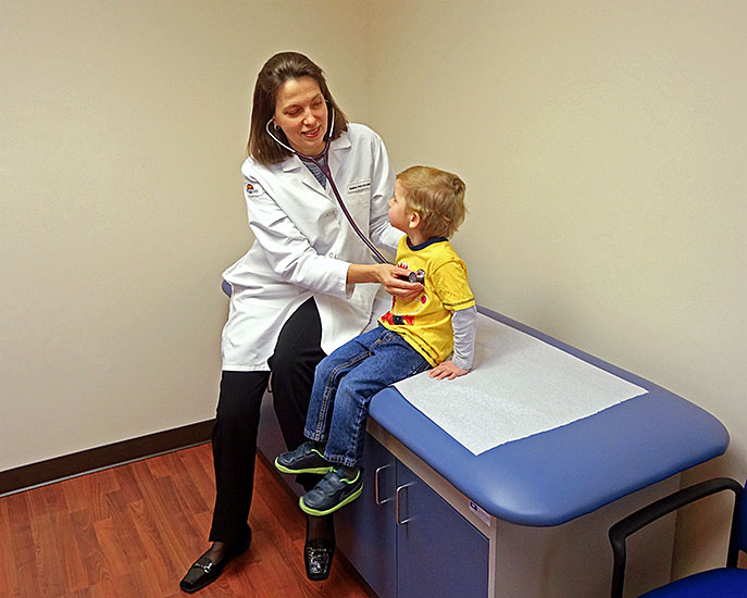 Holmdel, NJ pediatric office - Dr. Yelena Potylitsina checking a child's vitals